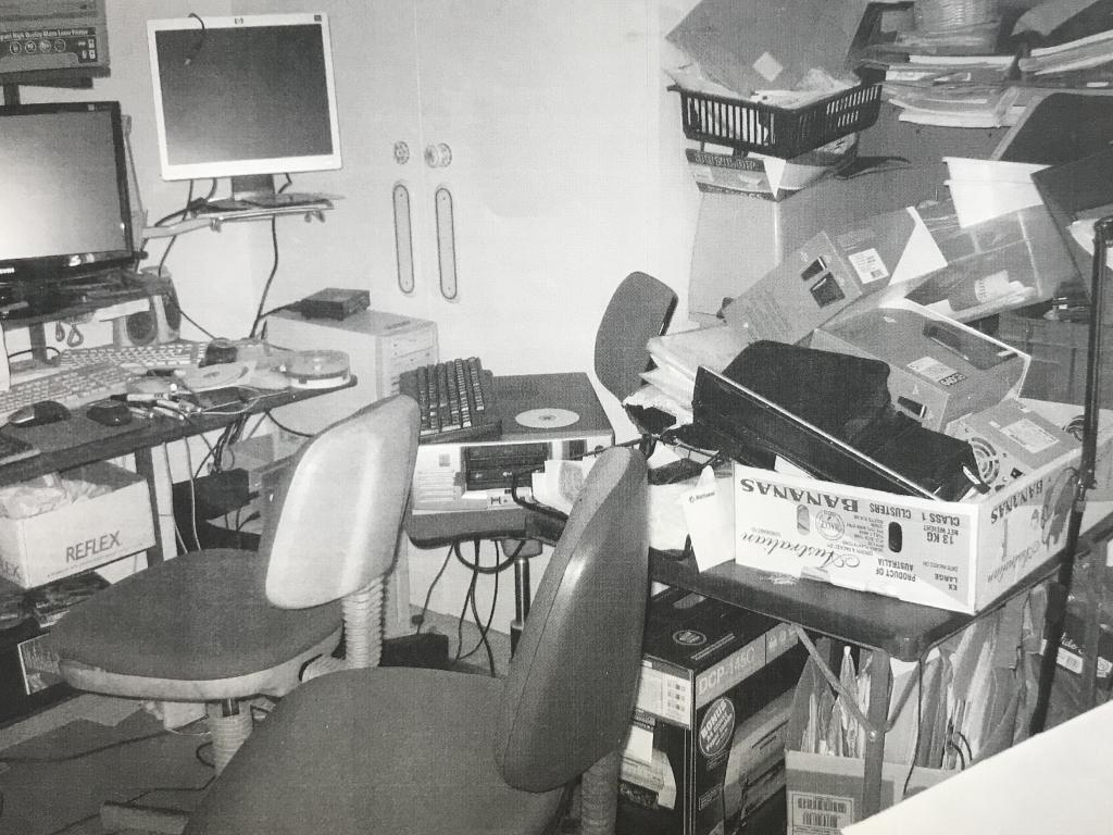 BEFORE: Judy's office space was full of clutter.