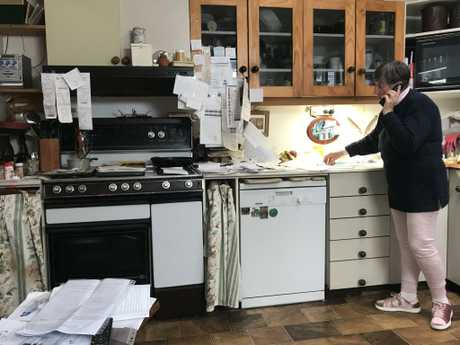 Judy's kitchen and dining area currently doubles as a paperwork space, as she admits hoarding is still an issue for her now.