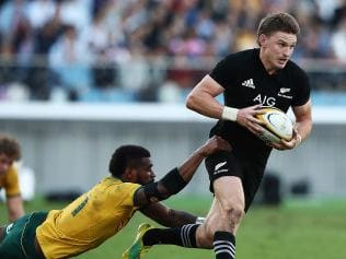 Beauden Barrett makes a break at Nissan Stadium in Yokohama. Picture: Hannah Peters/Getty Images