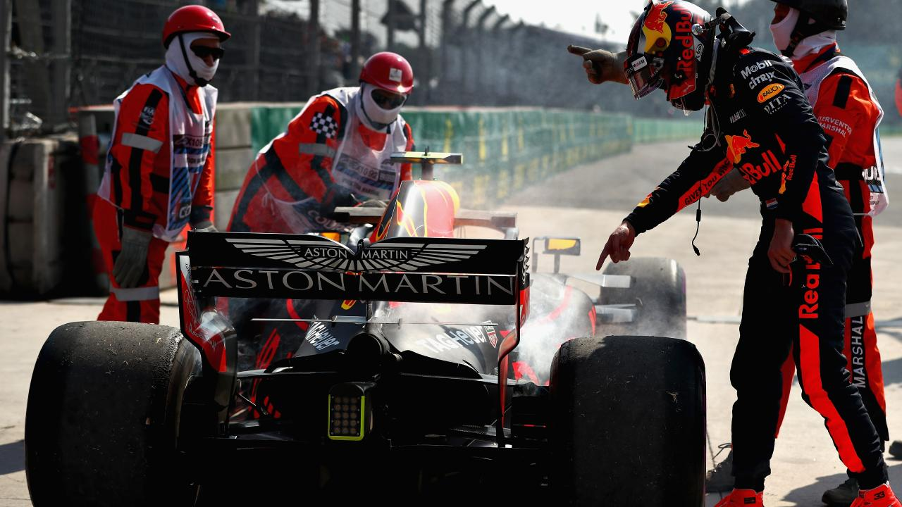 Max Verstappen and the Red Bull team inspect his car after it stopped during practice. Picture: Getty
