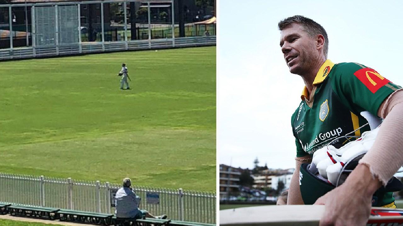 David Warner walks from the field during a Sydney grade cricket game.
