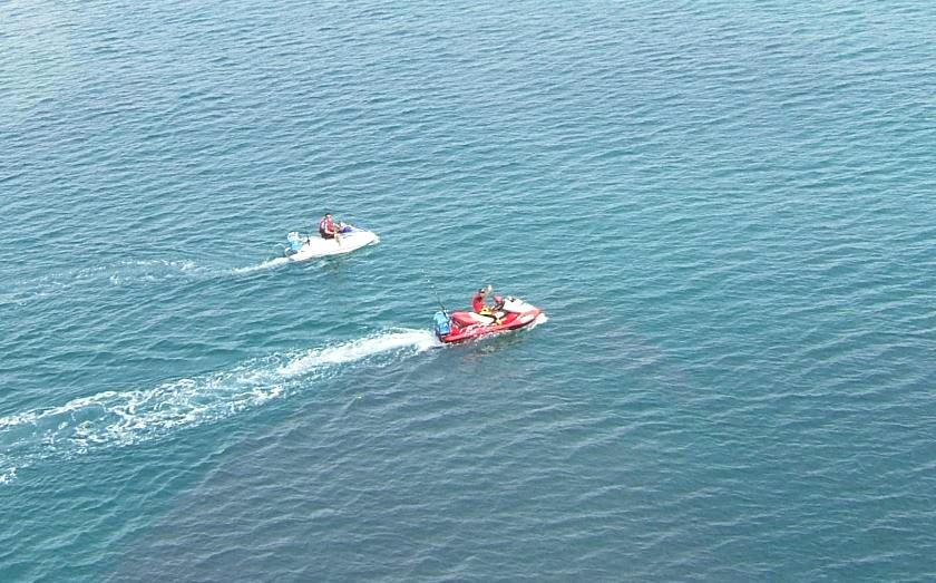 A person has been taken to hospital after they were hit by a jet ski.