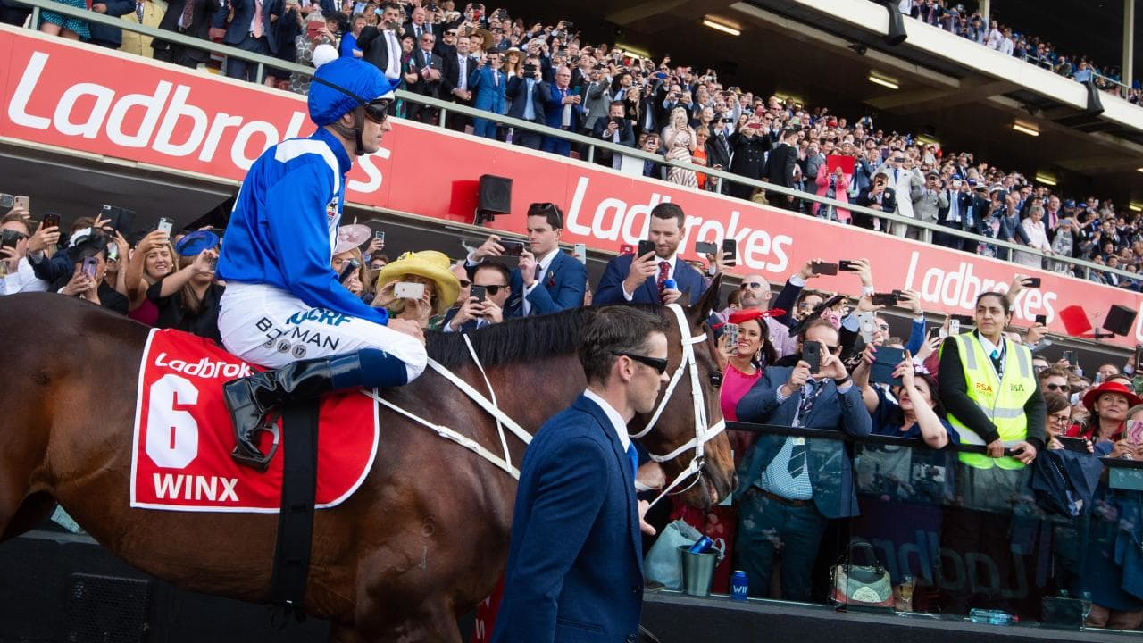 Cox Plate day at Moonee Valley Racecourse. Winx and Hugh Bowman get led onto the race course by track rider , Ben Cadden. Ben Picture Jay Town
