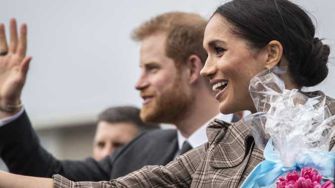 Prince Harry and Meghan Markle greet the crowd at Pukeahu National War Memorial Park. Picture: AAP