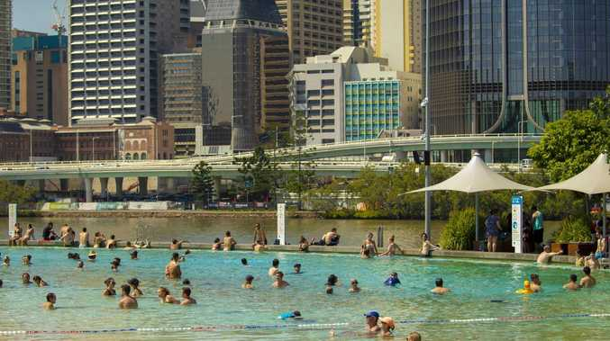 Brisbane might have escaped the worst of the heat but Streets Beach at South Bank was still packed. Picture: Glenn Hunt/AAP