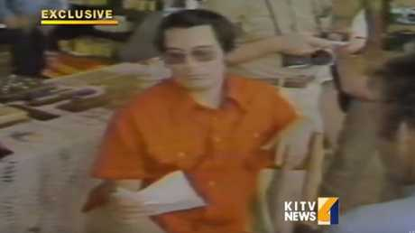 Jim Jones reads a note accidentally given to him before the defectors fled Jonestown, triggering the massacre.