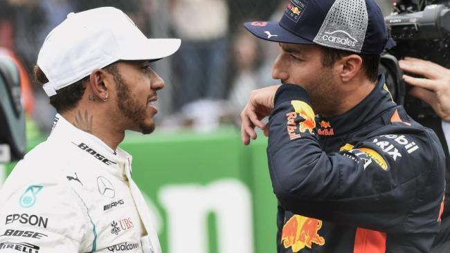 Lewis Hamilton congratulates Daniel Ricciardo after he claimed pole