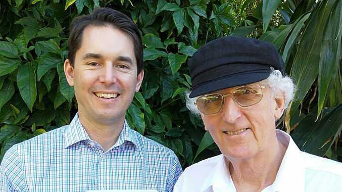 Fraser Coast Mayor George Seymour congratulates Hervey Bay author Tony Matthews on the publishing of A Dawn with no Birdsong.