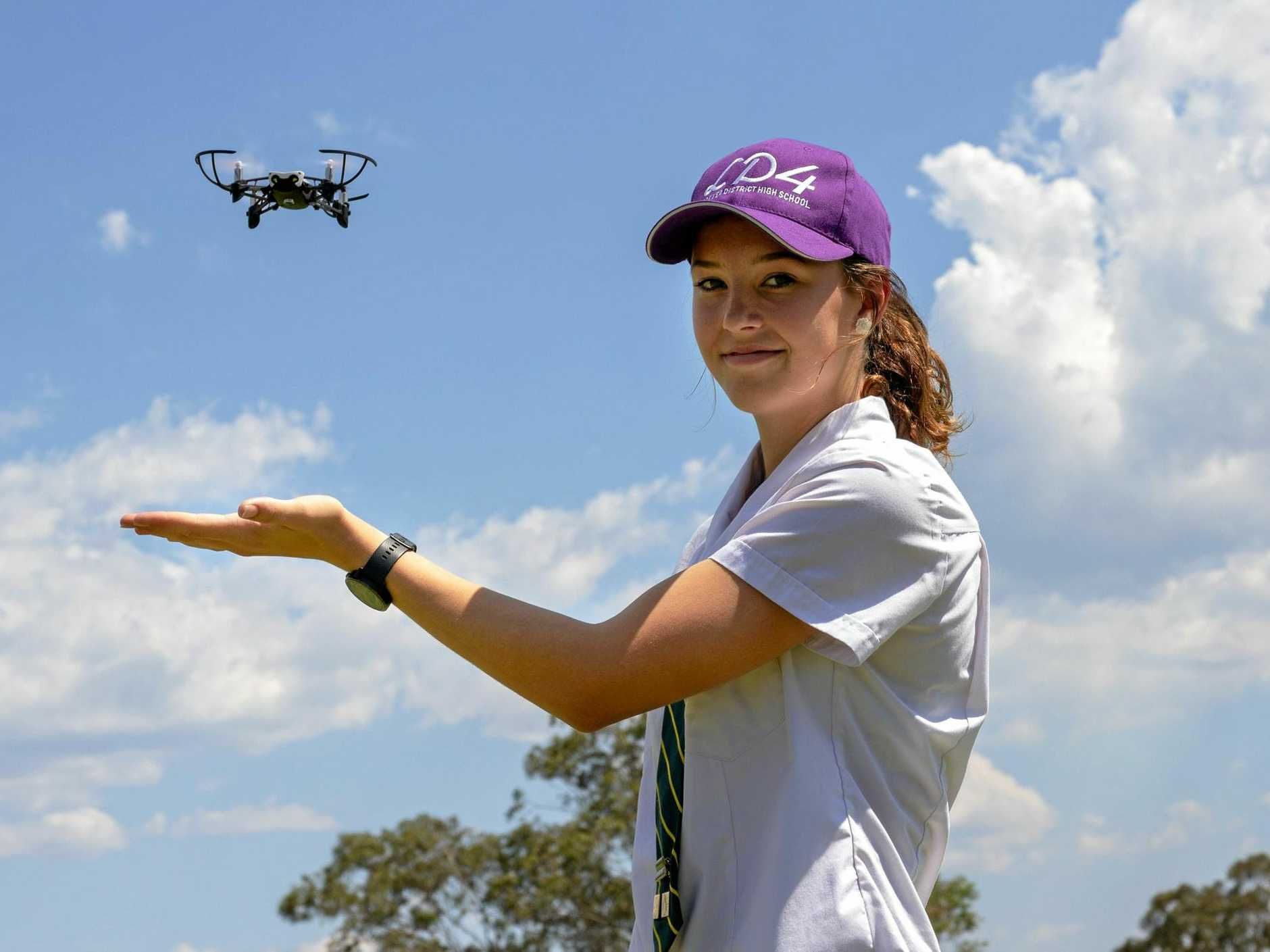 SKY-BOUND: Lockyer State High School student Emily Armitage with the school's agricultural drone.