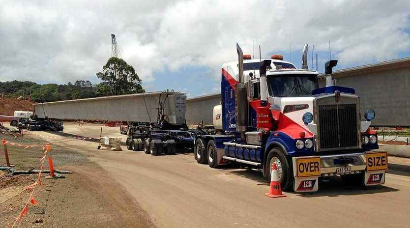 Large concrete girders are being delivered for the Pacific Highway upgrade.