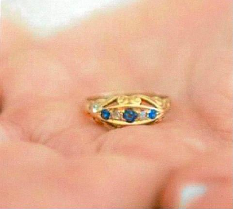 The sapphire and diamond gold ring.