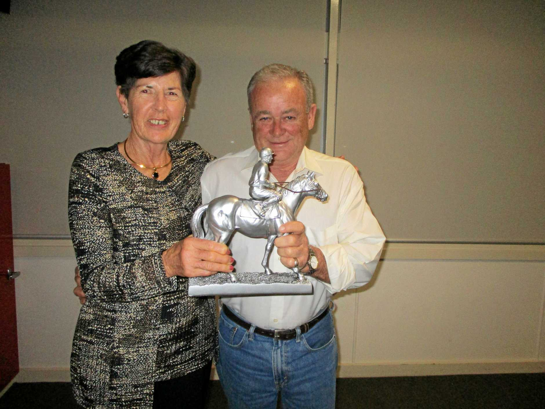 Grafton horse trainer John Shelton (right) accepts the Bob Gosling Memorial Award from the wife of the late Gosling, Lyn Gosling.
