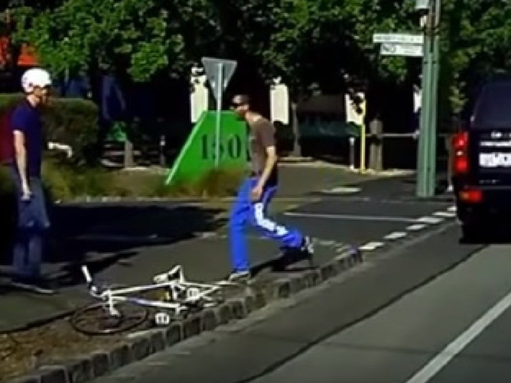 Walking over to the cyclist, the driver begins yelling and pointing at him. Picture: YouTube