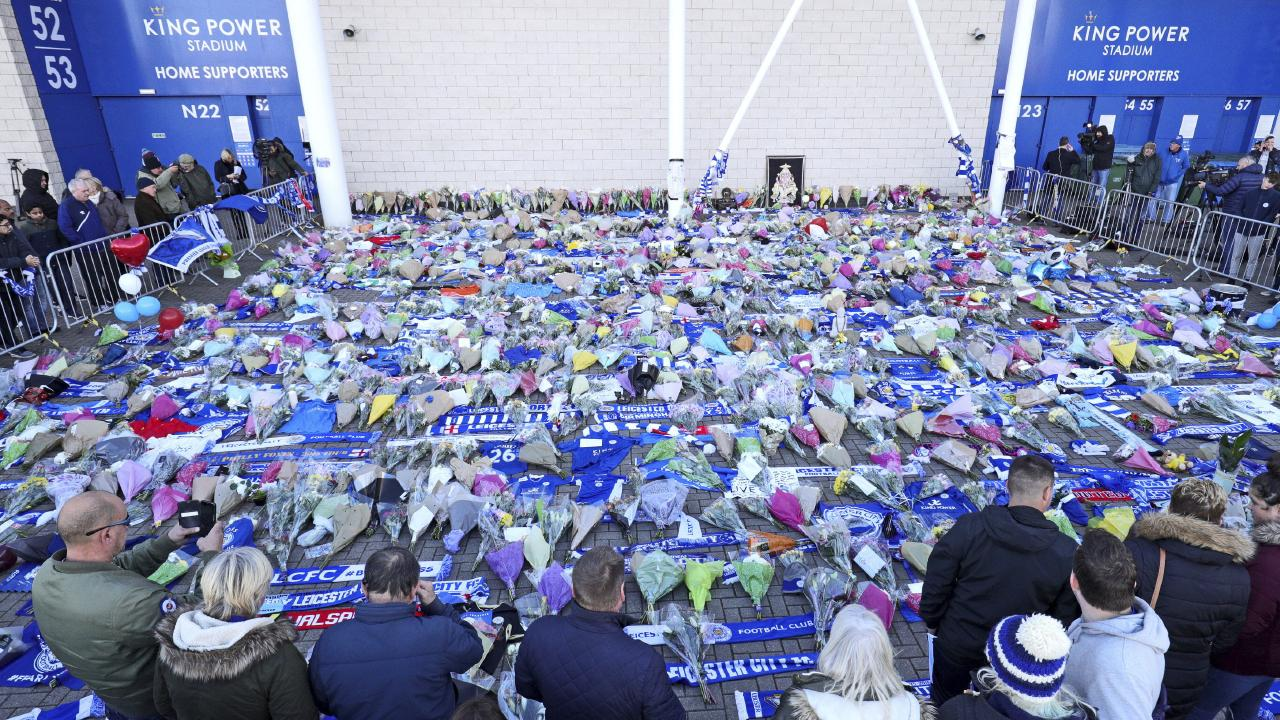 Supporters pay tribute to Vichai Srivaddhanaprabha outside Leicester City Football Club.