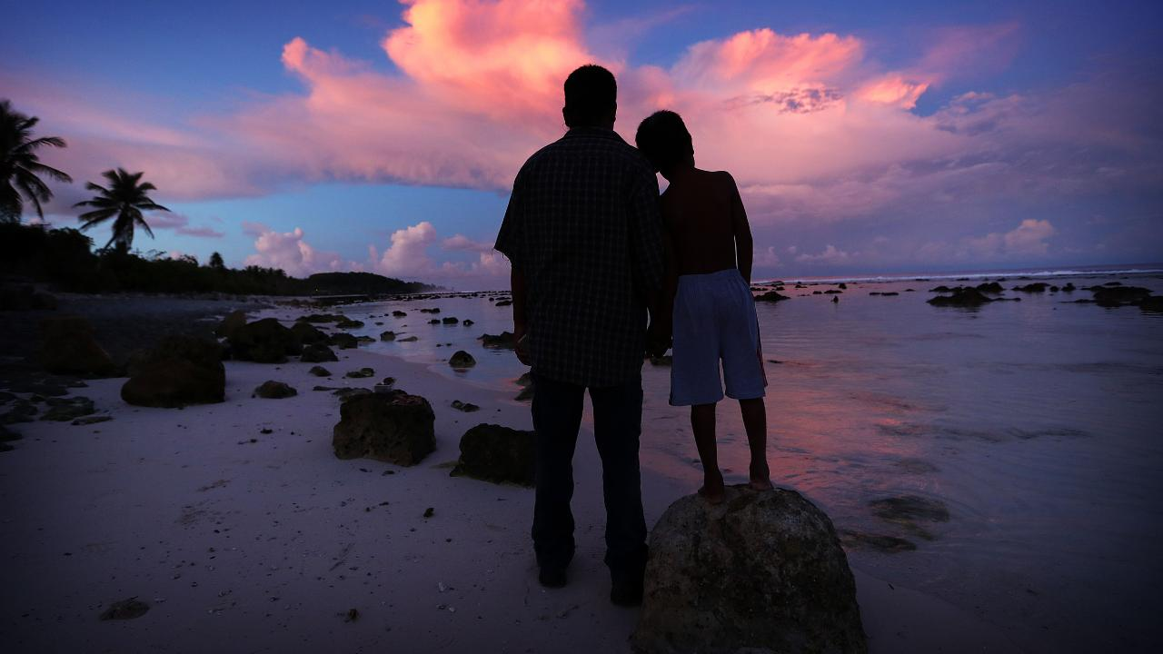 Asylum-seekers such as this father and son are free to roam on Nauru. They are not locked up. Picture: Lyndon Mechielsen