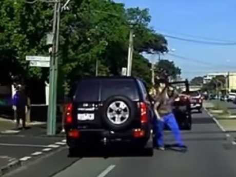 As the man gets to his feet, the furious motorist pulls over and gets out of his car. Picture: YouTube