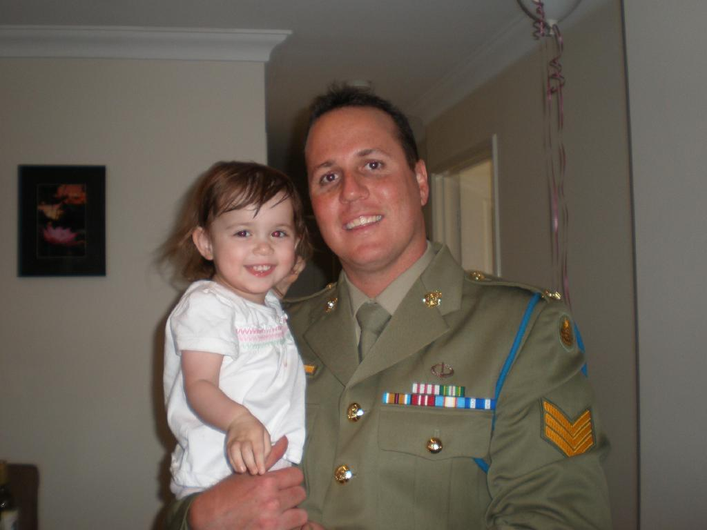 Brad Watt, in dress uniform, and Matilda are all smiles.