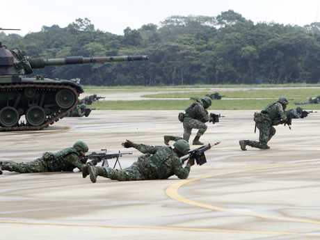 Taiwanese soldiers take part in a military drill in Taoyuan city, Nothern Taiwan. China has dramatically ramped-up what it calls 'encirclement' patrols around Taiwan. Picture: AP