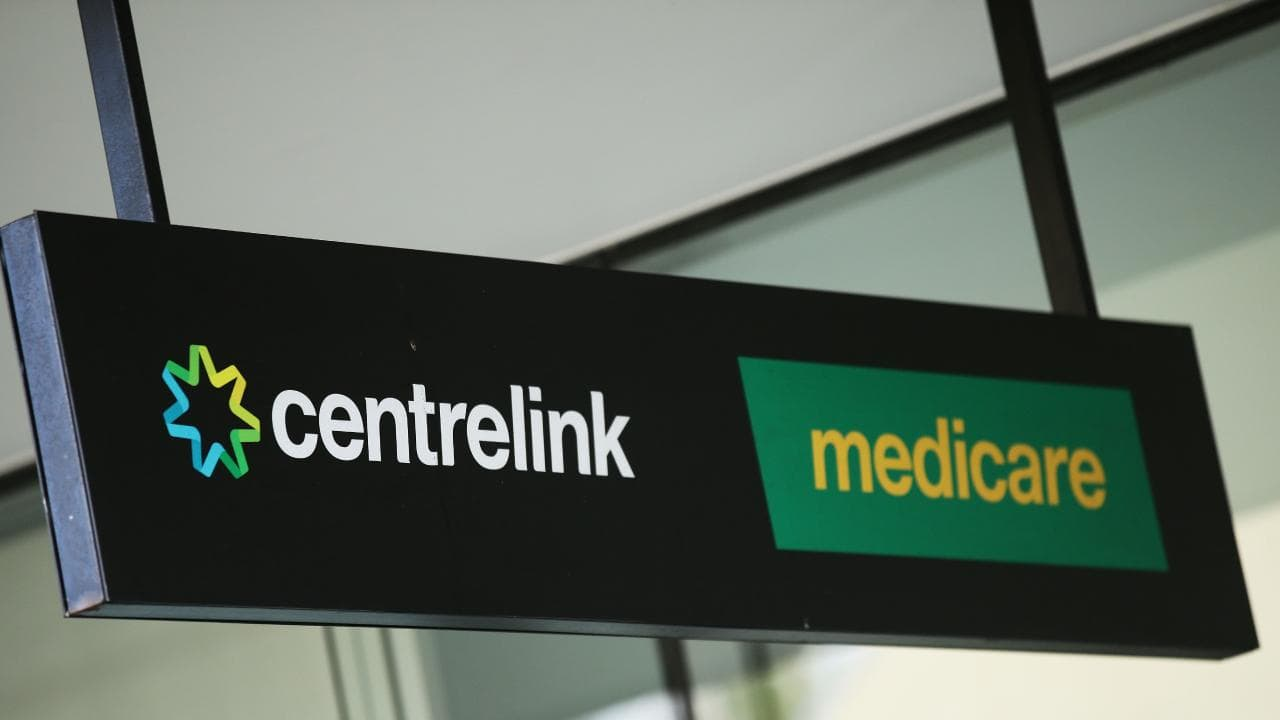 SYDNEY, AUSTRALIA — MARCH 21: A Medicare and Centrelink office sign is seen at Bondi Junction on March 21, 2016 in Sydney, Australia. Federal public sector workers are expected to strike around Australia over a long-running pay dispute. (Photo by Matt King/Getty Images)