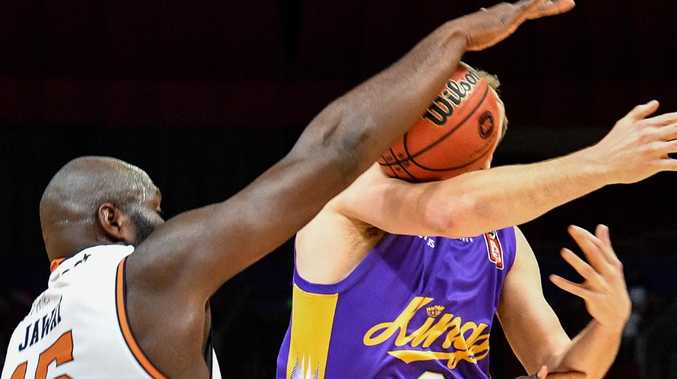 Lachlan Barker of Kings is seen competing for possession against Nate Jawai of the Taipans during the Round 3 NBL match between Sydney Kings and Cairns Taipans at Qudos Bank Arena in Sydney, Sunday, October 28, 2018. (AAP Image/Brendan Esposito) NO ARCHIVING, EDITORIAL USE ONLY