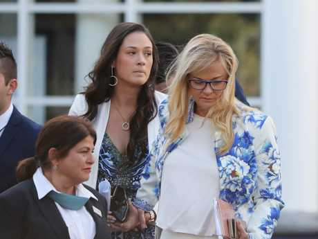 Paris' mum and sister pictured at her funeral in June.
