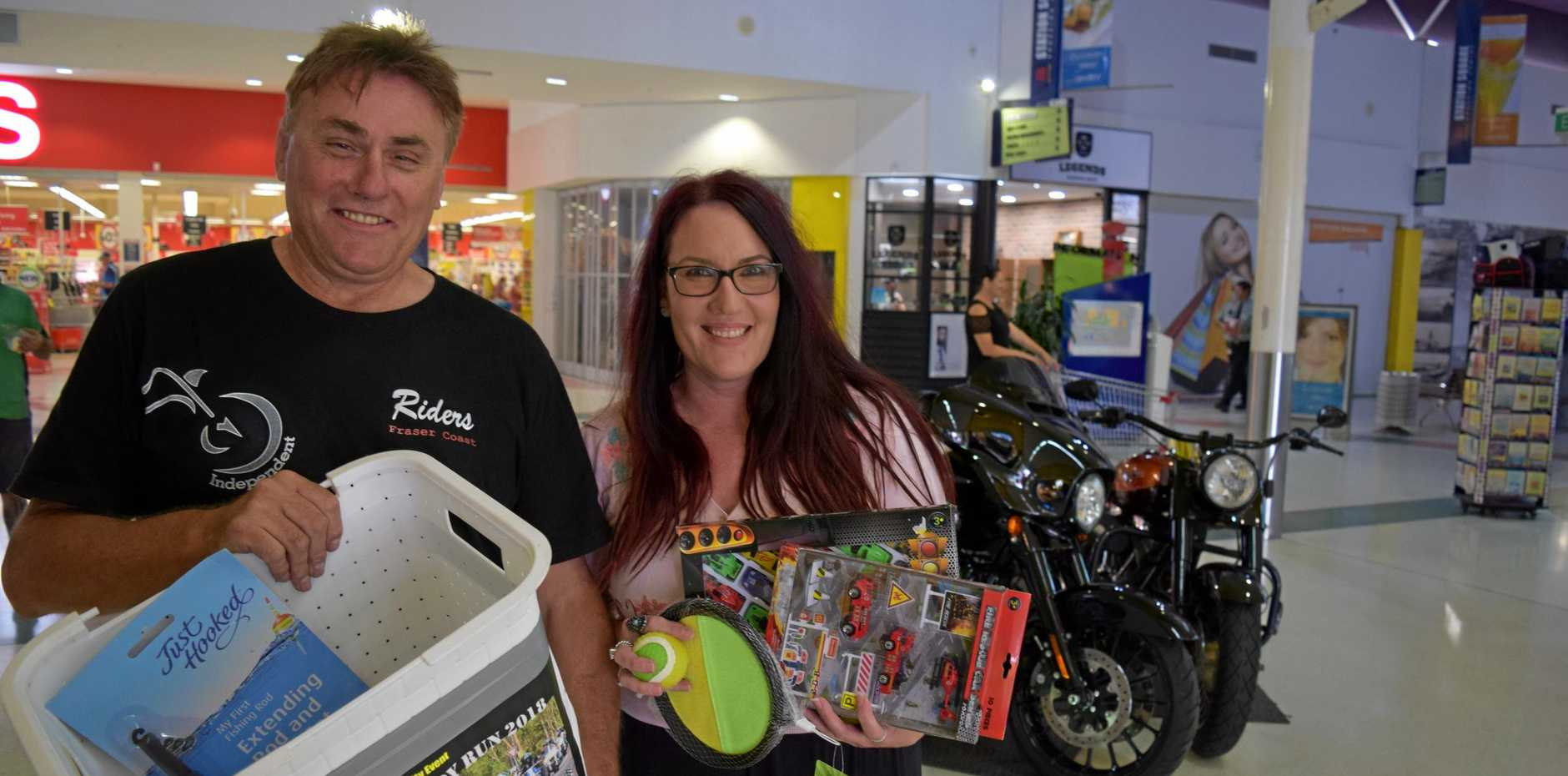 Independent Riders Fraser Coast's Michael Tucker with Fraser Coast Family Networks case manager Tammy Watton.