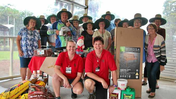 GREEN THUMBS: The Poona Community Gardening Group with Tam Geritz (front left) and Sarah Collins from Bunnings.