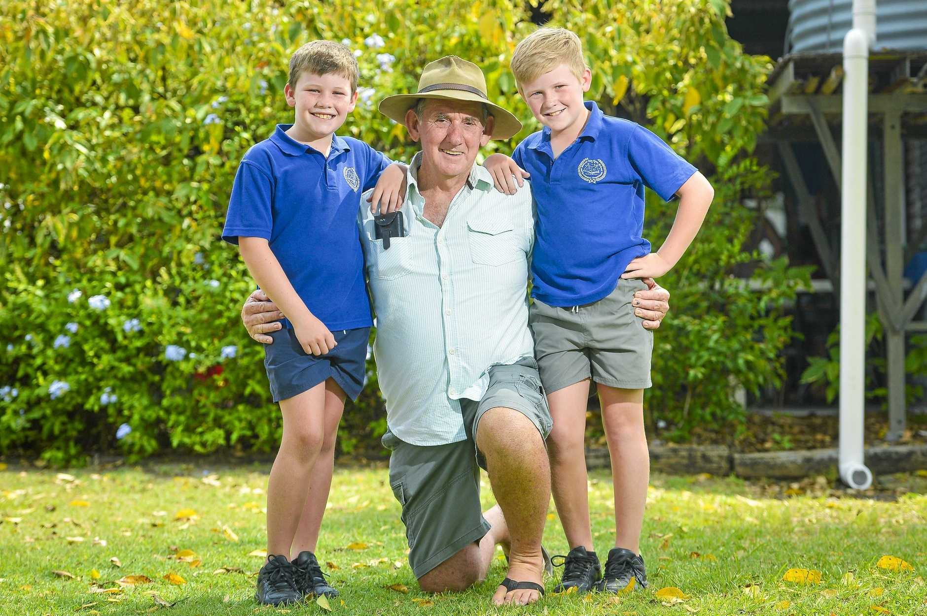 CLOCKING OFF: Lionel Bradford with grandkids Noah Coster, 9, and Ethan Coster, 11,  is retiring after 30 years' service as groundsman at Miriam Vale State School.