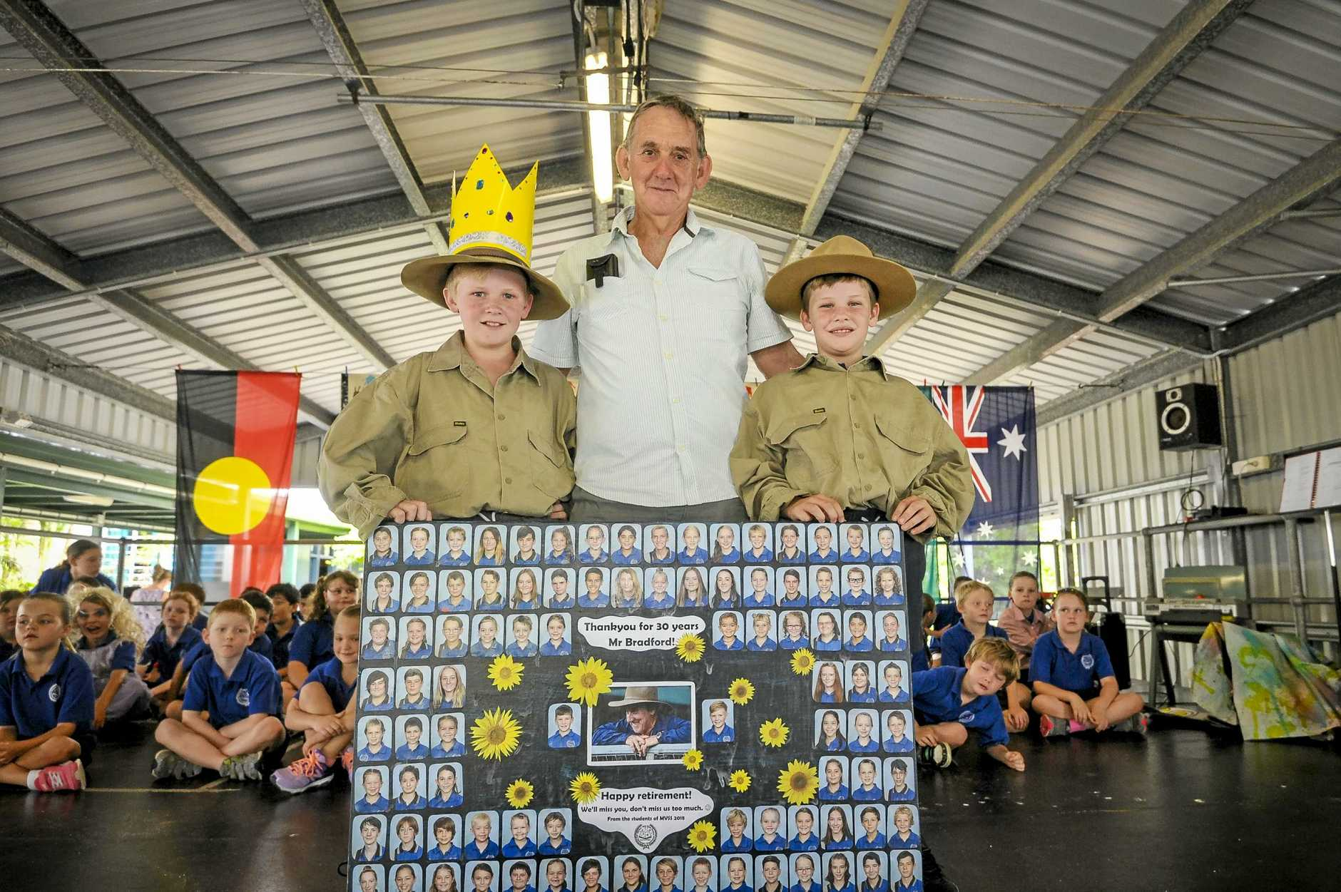 Lionel Bradford, pictured with grandkids Noah (9) and Ethan (11) Coster, is retiring after 30 years service as groundsman at Miriam Vale State School and was provided with a gift from the school.