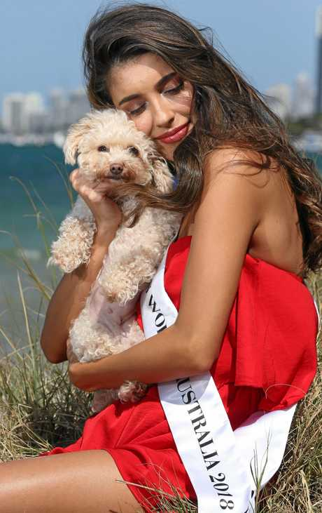 Gold Coast make-up artist Taylah Cannon, who was crowned Miss World Australia 2018, with her dog Lilah.