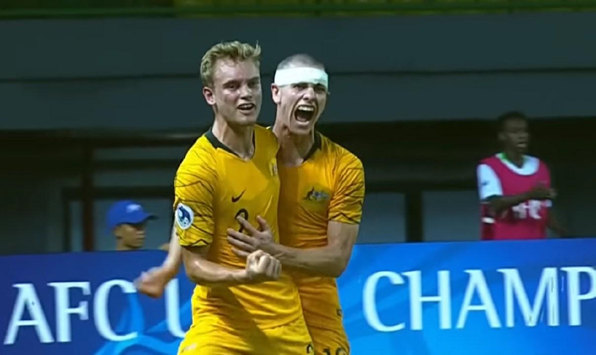 Nathaniel Atkinson celebrates scoring for Australia