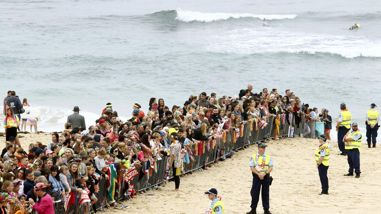 Big crowds wait for Prince Harry and Meghan, the Duchess of Sussex on Bondi Beach. Picture: John Appleyard