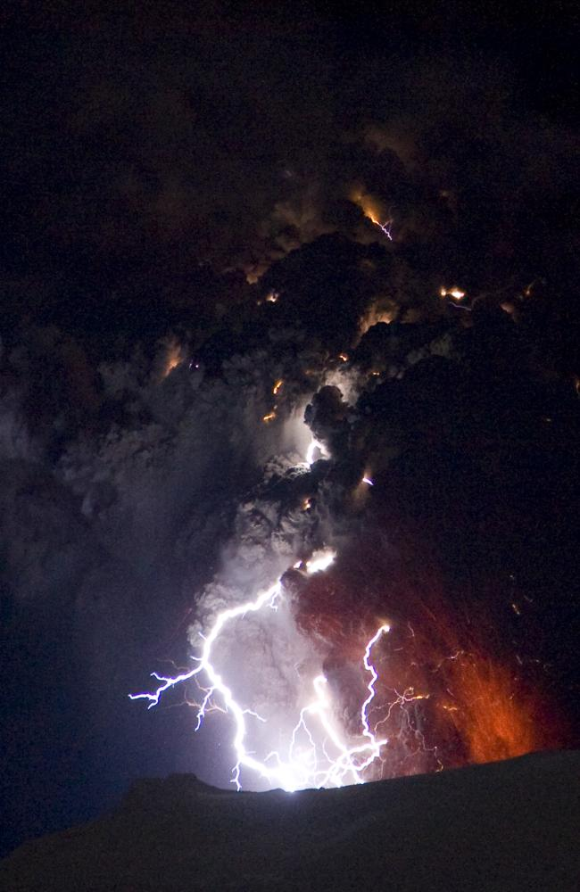 Lighting seen amid the lava and ash erupting from the vent of the Eyjafjallajokull volcano in central Iceland