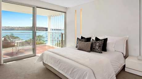 Every bedroom has water views — and the master also has a walk-in wardrobe and balcony. Picture: Matrix