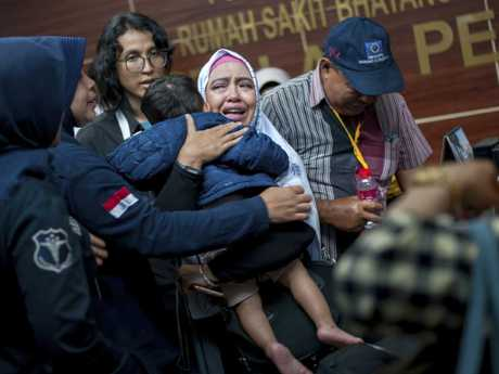 A family member  cries at the police hospital in Jakarta. Picture: AP