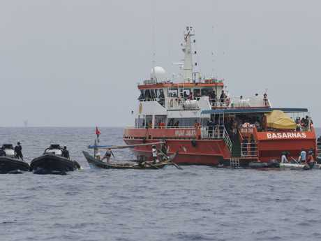 Rescuers conduct the  search operation. Picture: AP