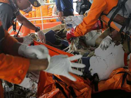 Rescuers inspect parts of the crashed Lion Air plane during a search operation in the waters of Tanjung Karawang. Picture:AP