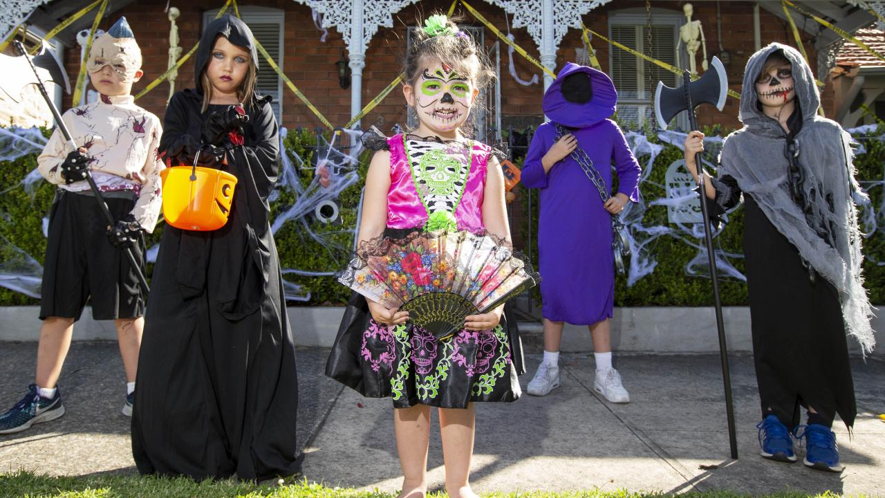 Harvey, 8, and Mischa, 8, and Ella, 3, Samuel, 10, and Joshua, 7, prepare for trick-or-treating. Picture: Justin Lloyd