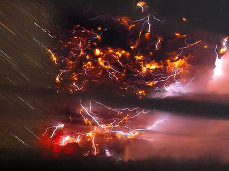 Volcanic lightning is seen flickering through the ash plume in this timelapse picture of the Puyehue volcano in 2011. Picture: AP