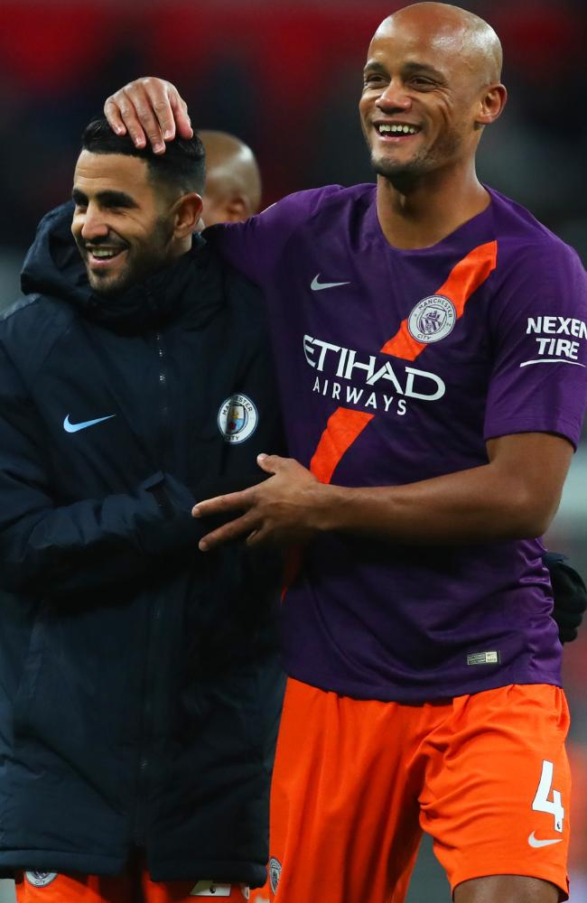 Riyad Mahrez is congraulated by Vincent Kompany after City's win.