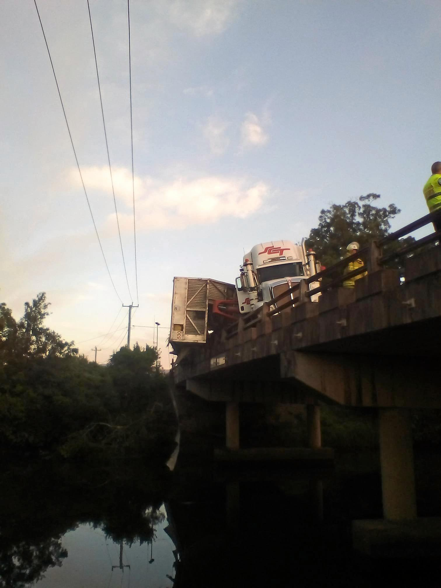 A semi trailer had collided with the guard rail of the Kynnumboon bridge.