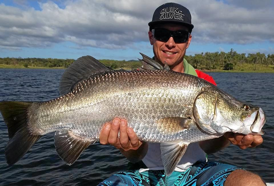 REEL BIG FISH: Luke Clow holds up a solid barra from Lake Awoonga during the 2017-18 closed season.