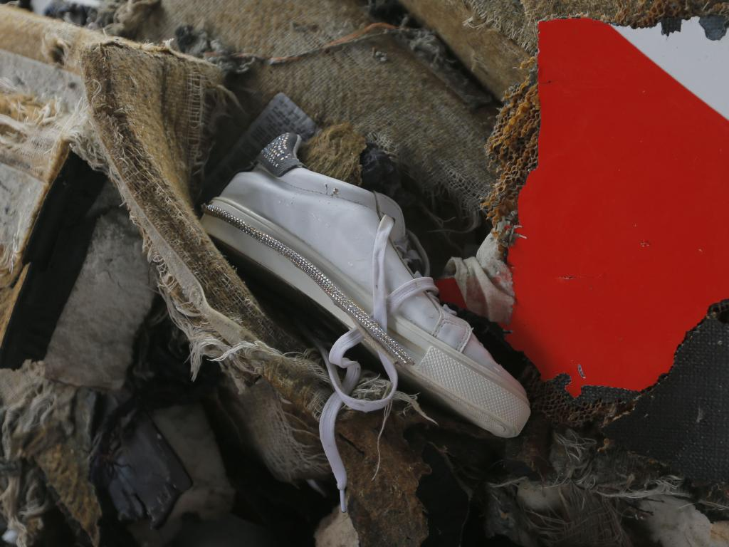 A shoe and parts of the crashed Lion Air plane are among debris retrieved from the waters. Picture: AP