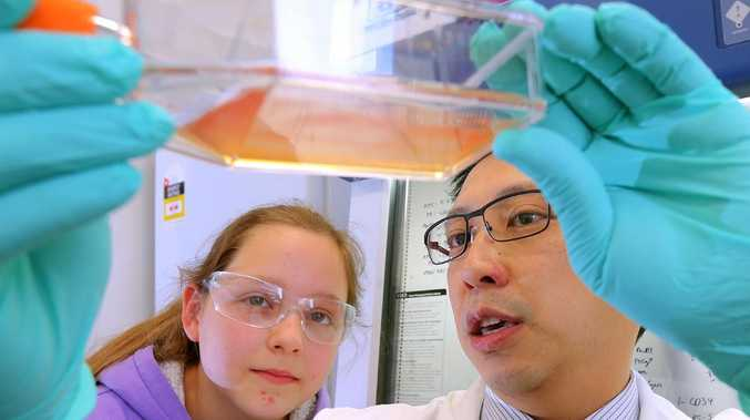 Dr Jason Tye-Din shows Coeliac disease sufferer Riley Nicholls, 11, some coeliac patients bloods cells grown in the laboratory at the Walter and Eliza Hall Institute in Parkville. Picture:Ian Currie
