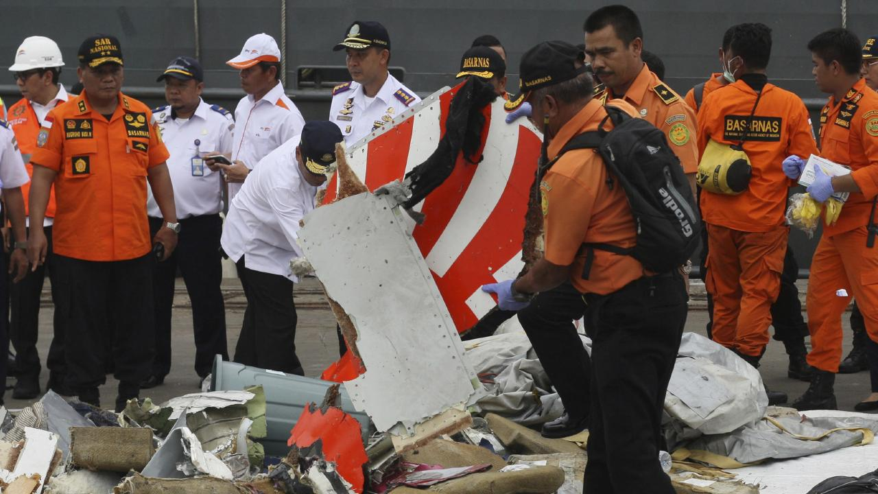 A rescuer inspects a part of Lion Air plane flight JT 610 retrieved from the waters where it's believed to have crashed. Picture: AP/Binsar Bakara