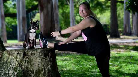 Macey Smith gets fit under the watchful eye of her Boston terrier, Harvey, at Anderson Park. Picture: Evan Morgan