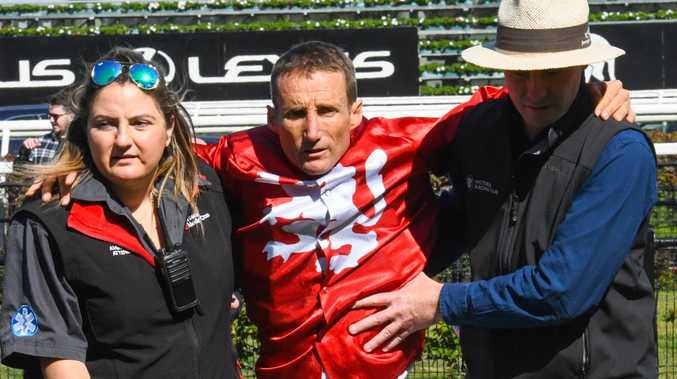 Damien Oliver was assisted off the track after hurting his leg in a barrioer incident at Flemington in September. Picture: Getty Images