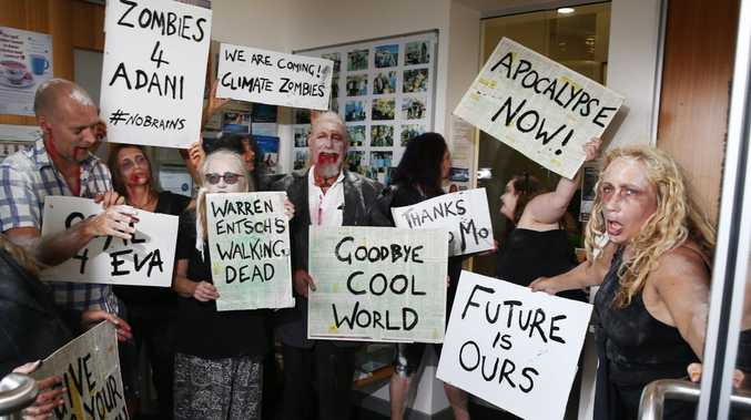Stop Adani protesters have marched on Member for Leichhardt Warren Entsch's electoral office dressed as zombies.  Picture: Brendan Radke