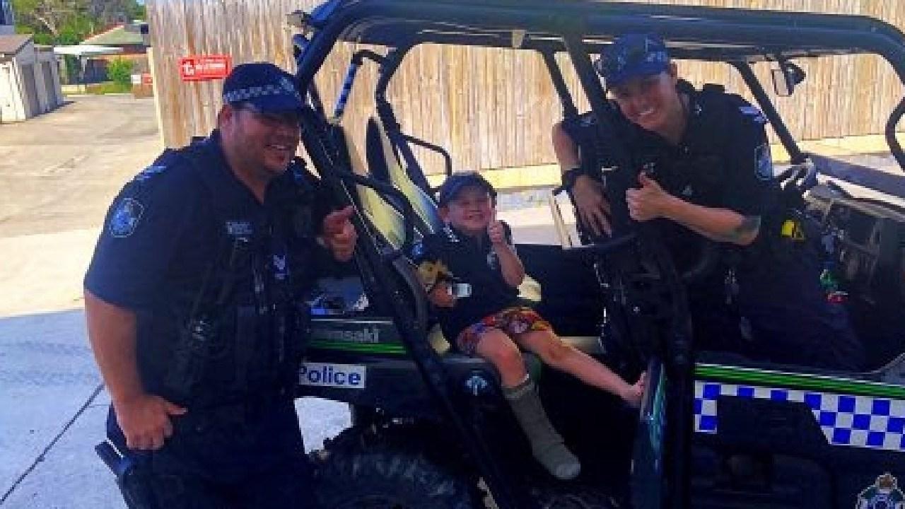 Senior Constable Cameron Preston and Senior Constable Jen Wallis with the boy.