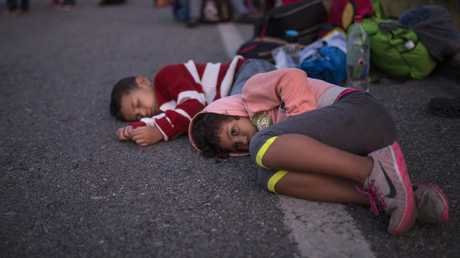Children from the migrant caravan wait for a ride on the side of the road in Mexico as the thousands of asylum seekers continue their slow march toward the US border. Picture: Rodrigo Abd/AP